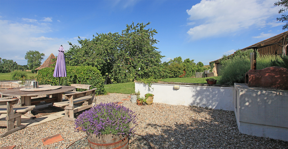 The terrace is just off the kitchen and has large dining table, pizza oven and lovely views