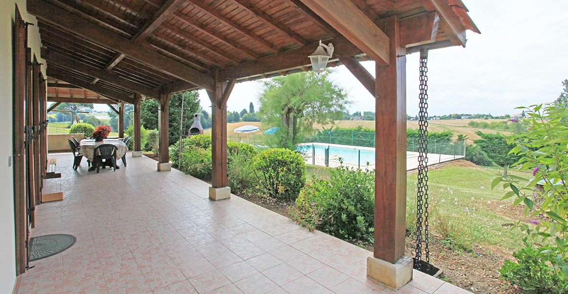 The front covered terrace overlooks the pool