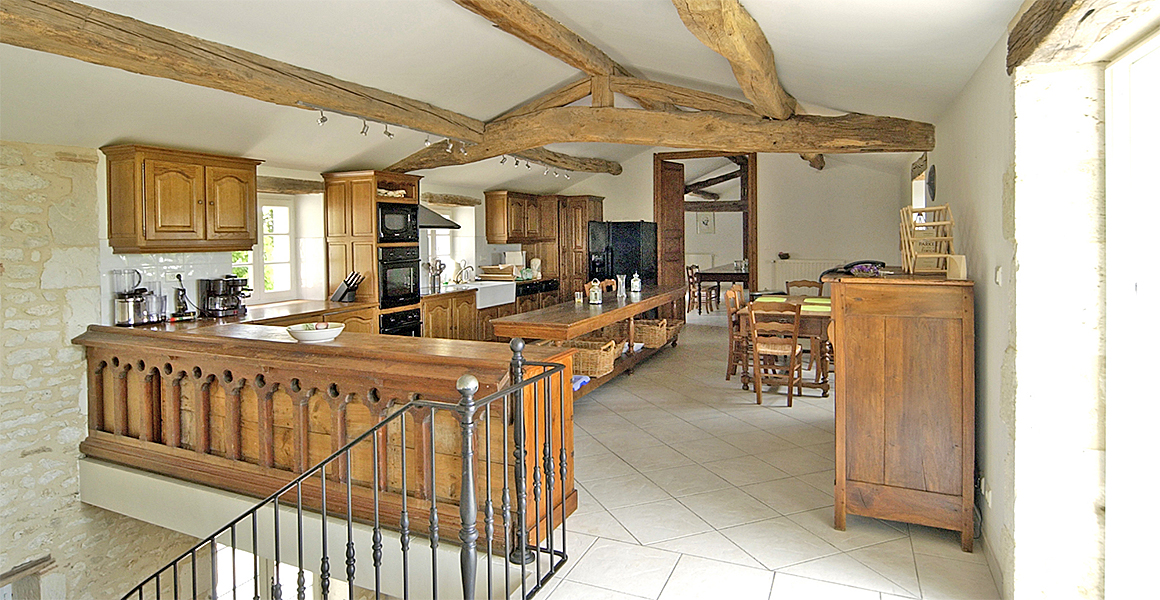 The large kitchen with access to the dining room and out onto the balcony