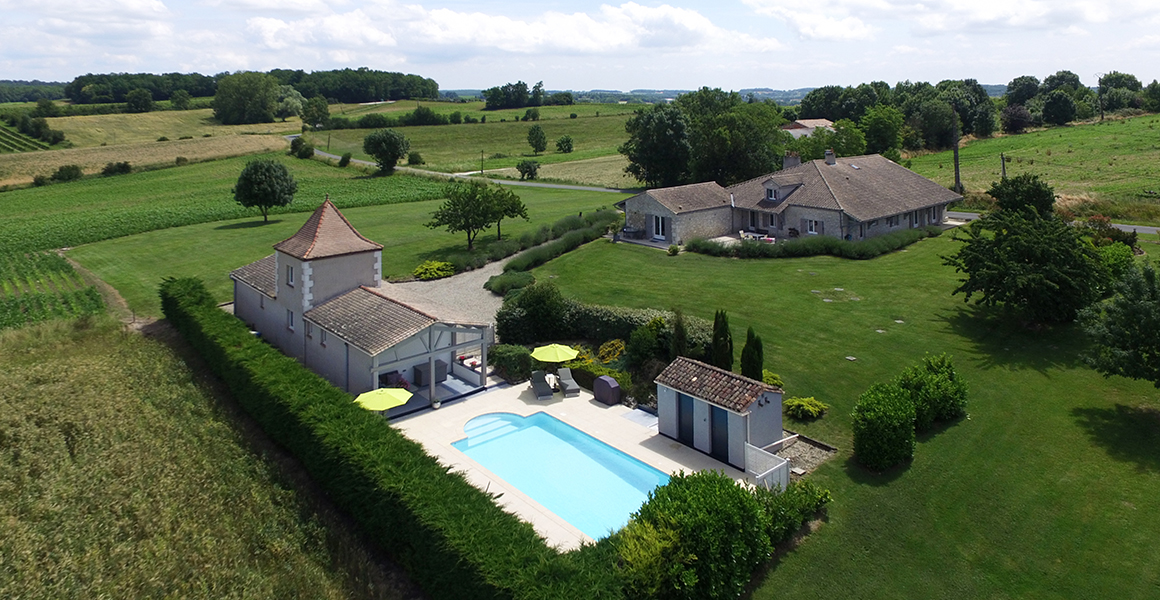 Les Couroux aerial view showing the three gites, pool and gardens