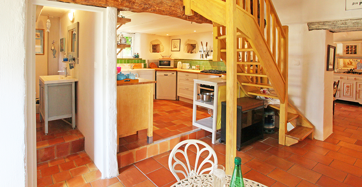 Large gite kitchen with stairs to mezzanine bedroom