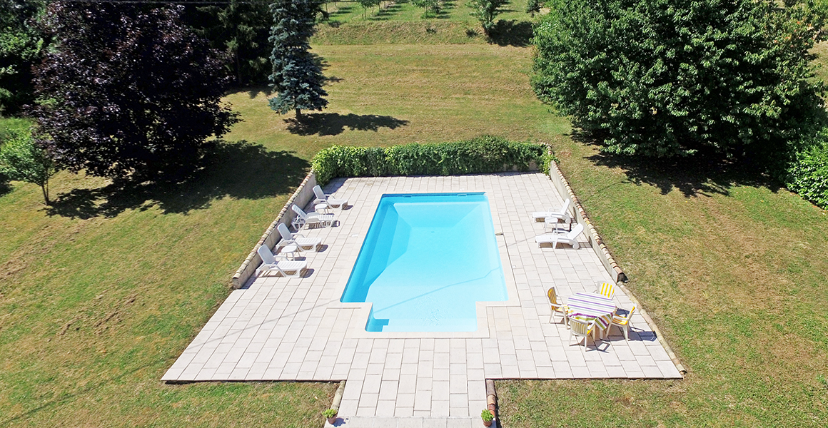 The fabulous private pool, gardens and orchards beyond