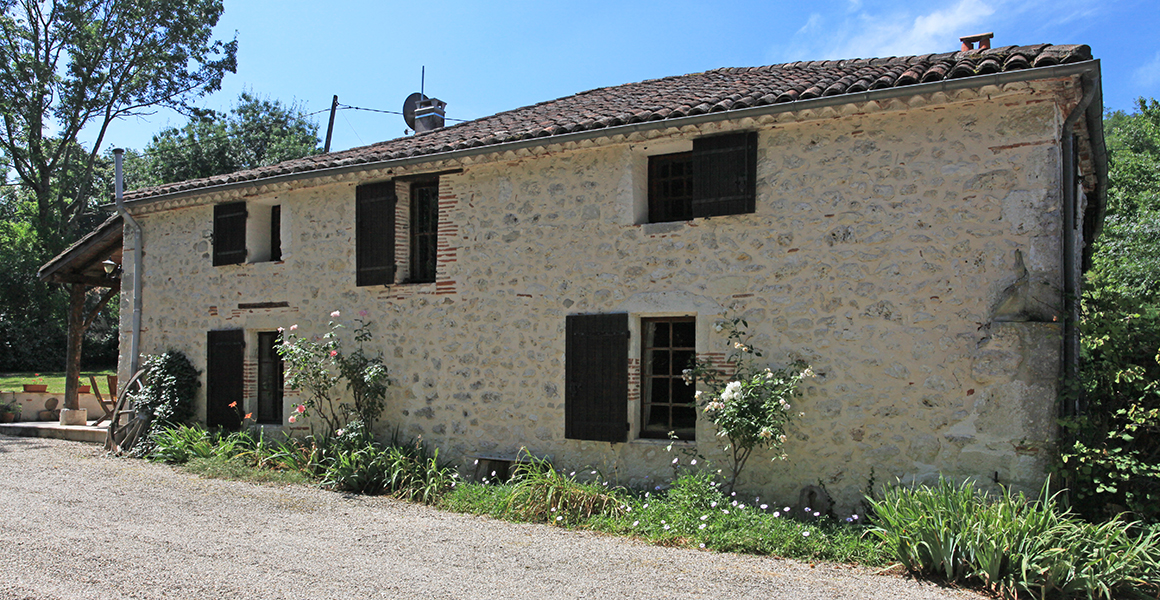 The front of the farmhouse with plenty of private parking